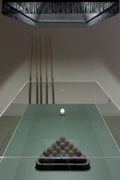 Threeway pass (Draw Ball / Dead Ball / Follow Shot), 2011. Vitrine including 21 unique hand-polished coal eggs and one hard-boiled egg on golden holder, 100 x 125 x 70 cm. Black Lampshade with cord and lace, 35 x 95 x 40 cm