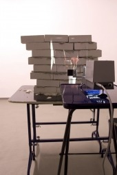 Tabledance (with Nadja Abt), 2010. Installation view (past performance). Bricks, slide, paper, wood, concrete and slide projection, dimensions variable
