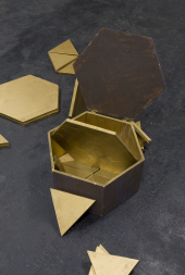 Hatbox (detail),1975. Triangular and hexagonal pieces of gold-painted sheetrock in artist-made and painted wooden box, 27 x 50 x 50 cm (enclosed)